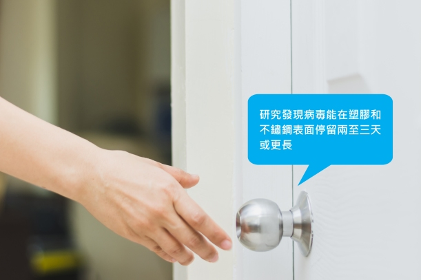 close up of woman's hand reaching to door knob, opening the do